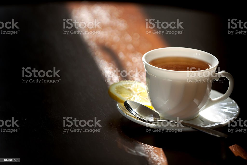 Cup of tea and saucer with lemon . royalty-free stock photo