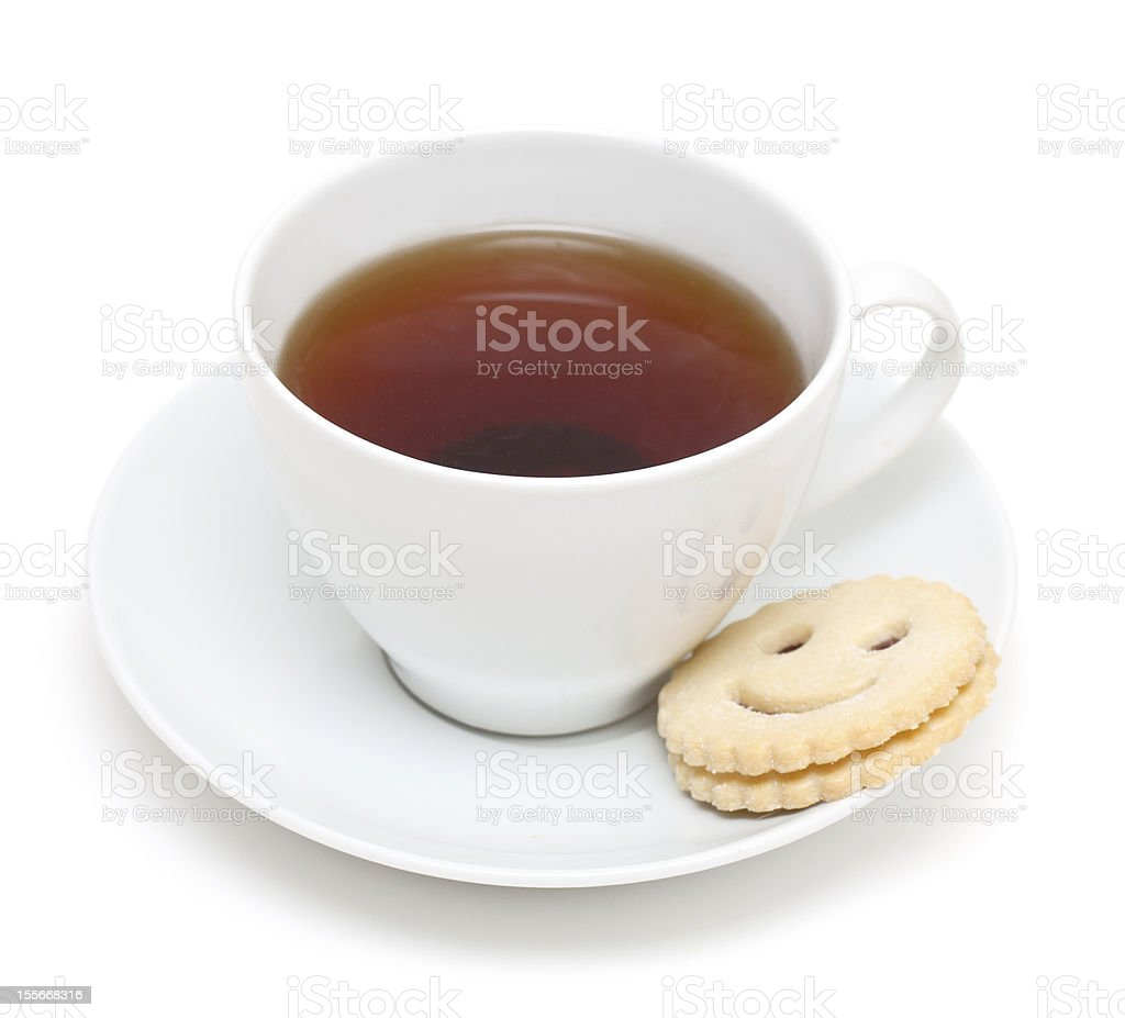 cup of tea and smiling cookie stock photo