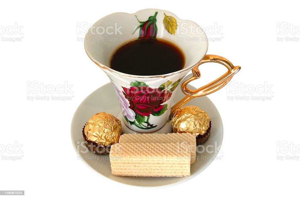 Cup of tea and sweeties. royalty-free stock photo