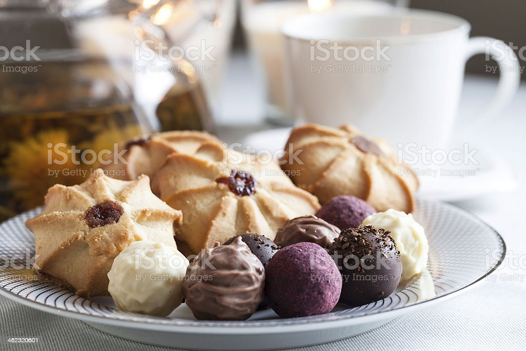 Cup of tea and sweets stock photo