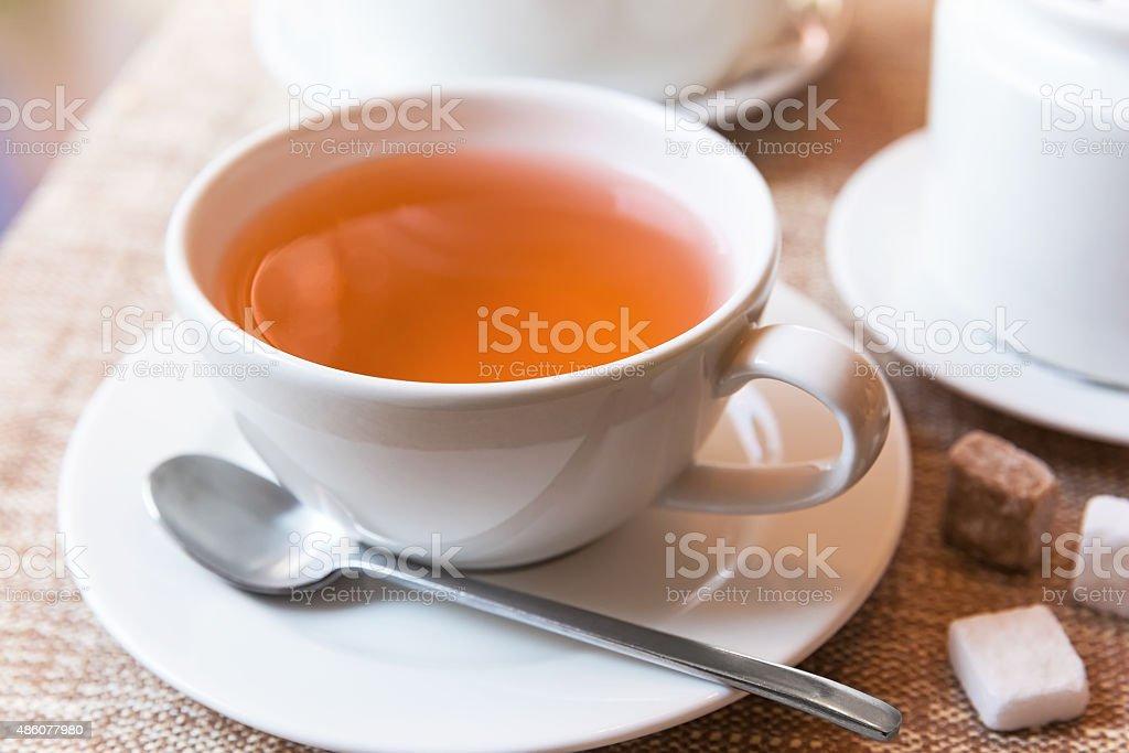 Cup of tea and tea pot stock photo