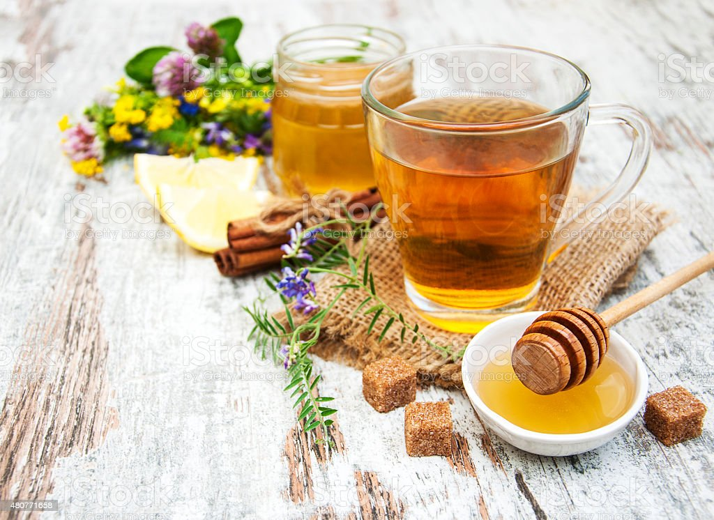 Cup of tea, honey and flowers stock photo