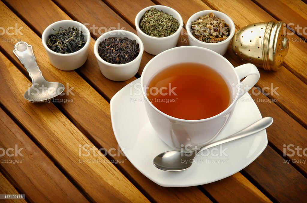 Cup of tea made from fresh tea leaves royalty-free stock photo