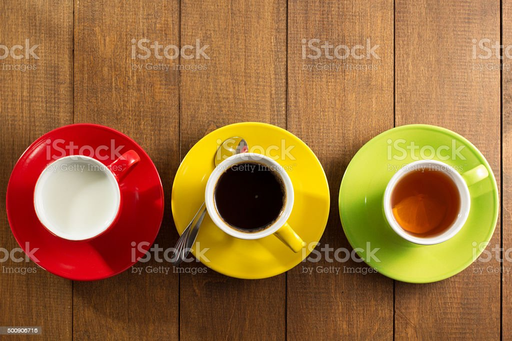 cup of tea, milk, coffee on wood stock photo