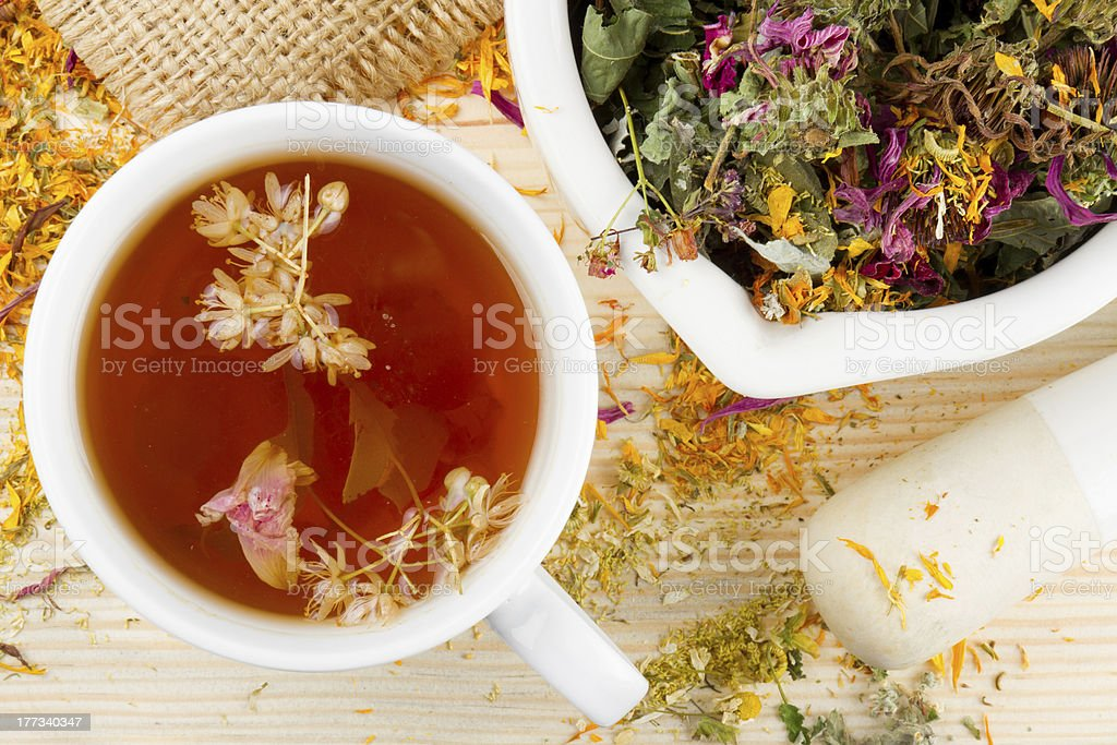 cup of tea, mortar and pestle with herbs royalty-free stock photo