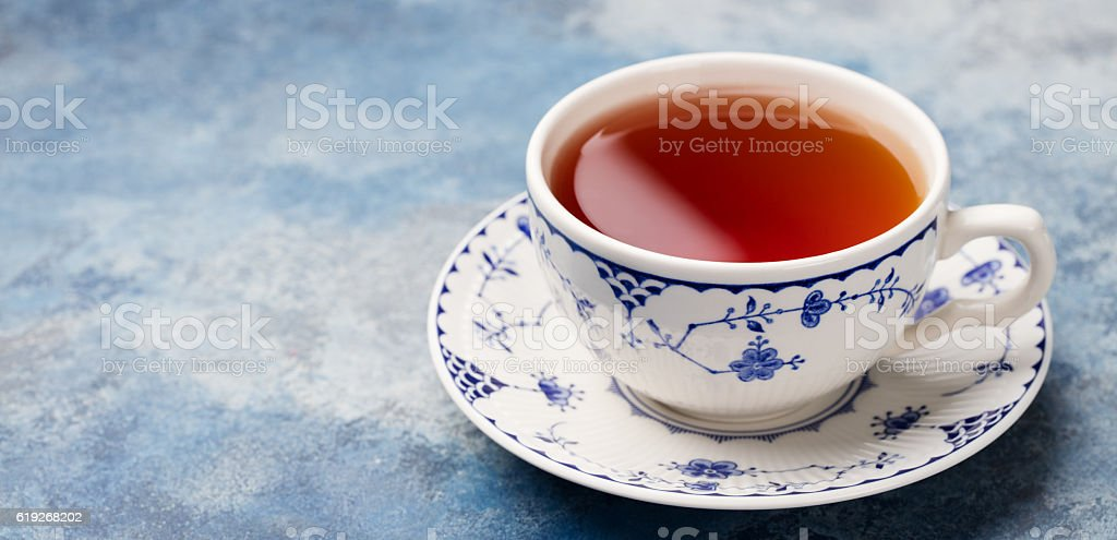 Cup of tea on a blue stone background. Copy space stock photo
