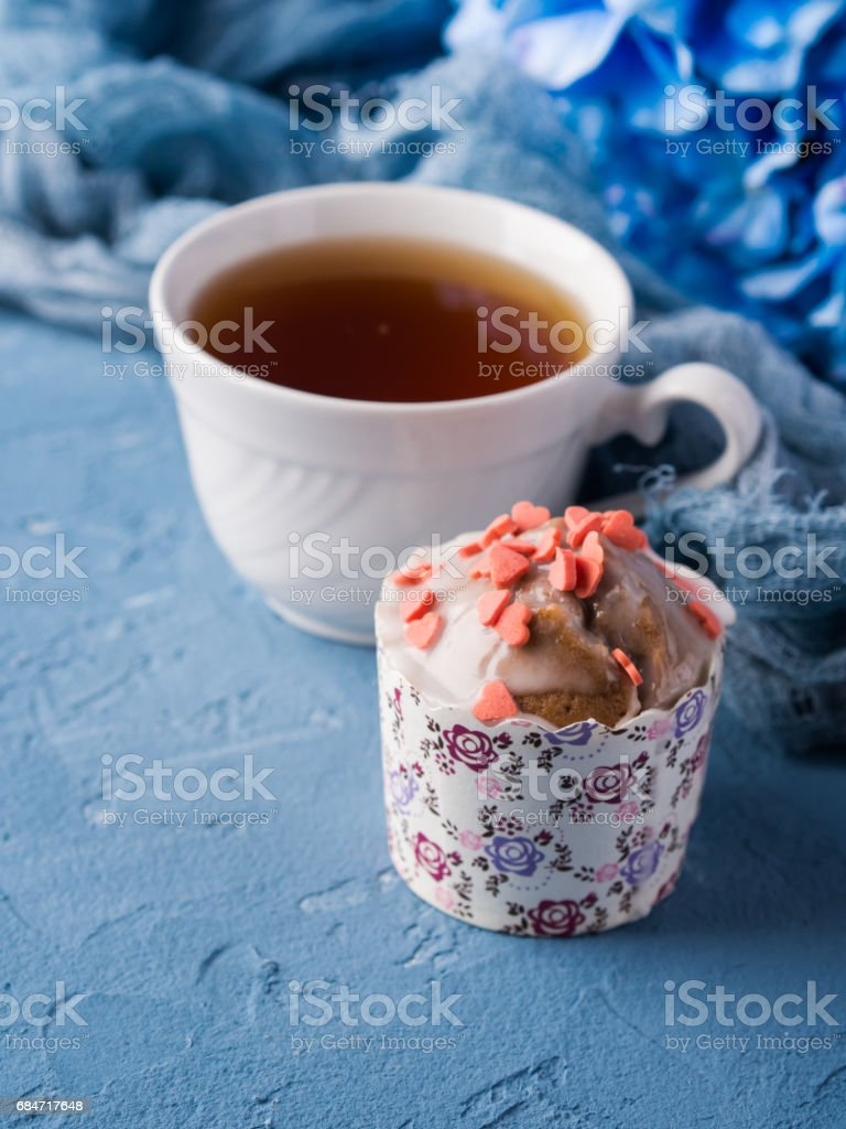 Cup of tea on blue background with flowers stock photo