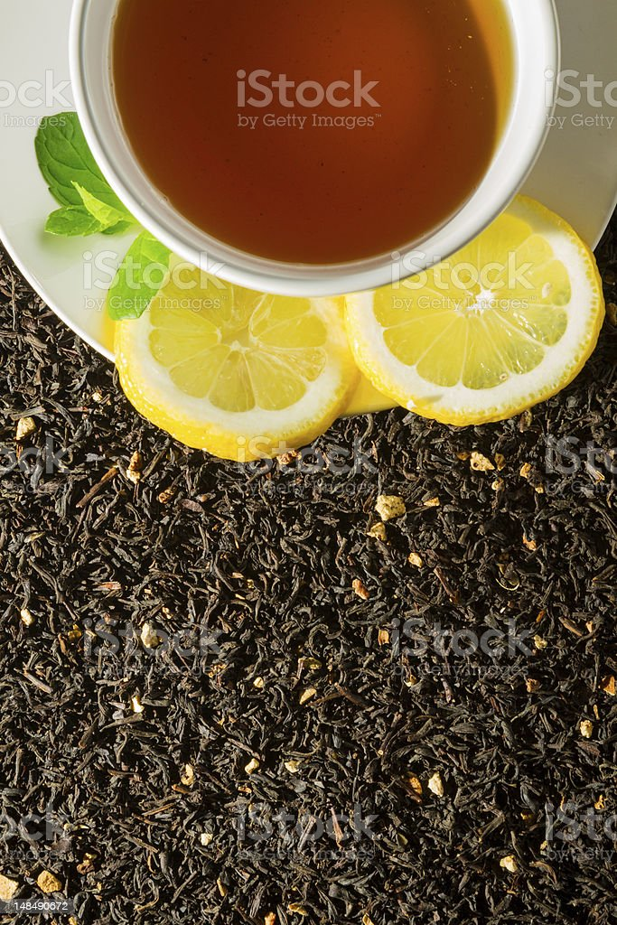 Cup of tea on dry herbs royalty-free stock photo