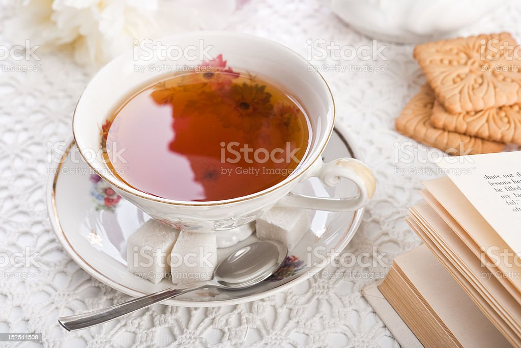 Cup of tea on lacy cloth royalty-free stock photo