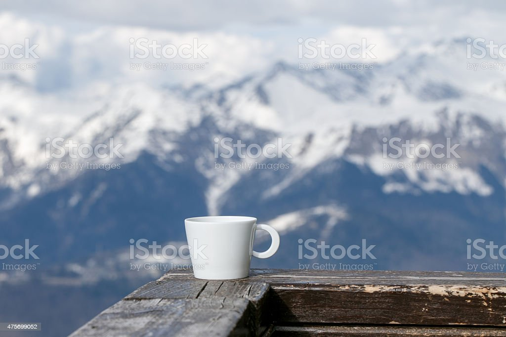 Cup of Tea on Mountains Background stock photo