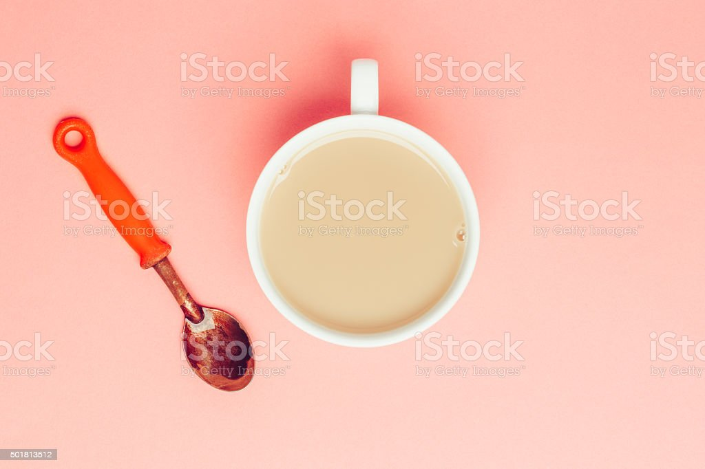 Cup of tea on pink background stock photo