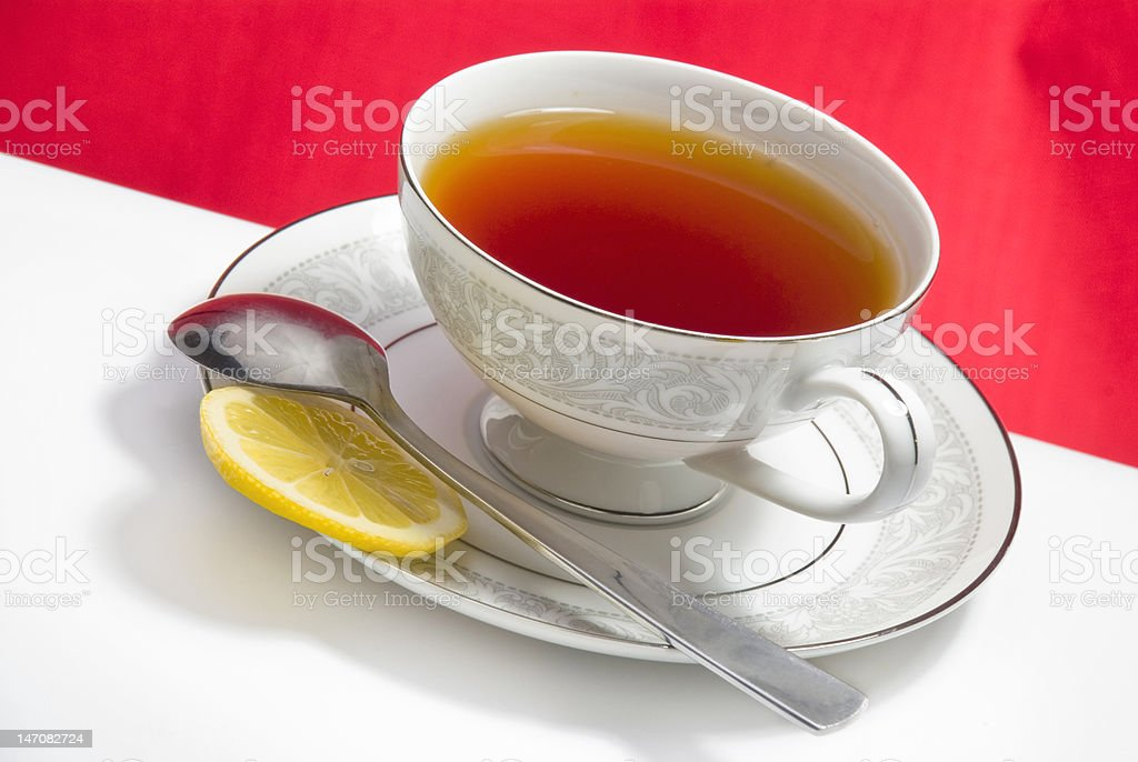 Cup of Tea on Red Background royalty-free stock photo