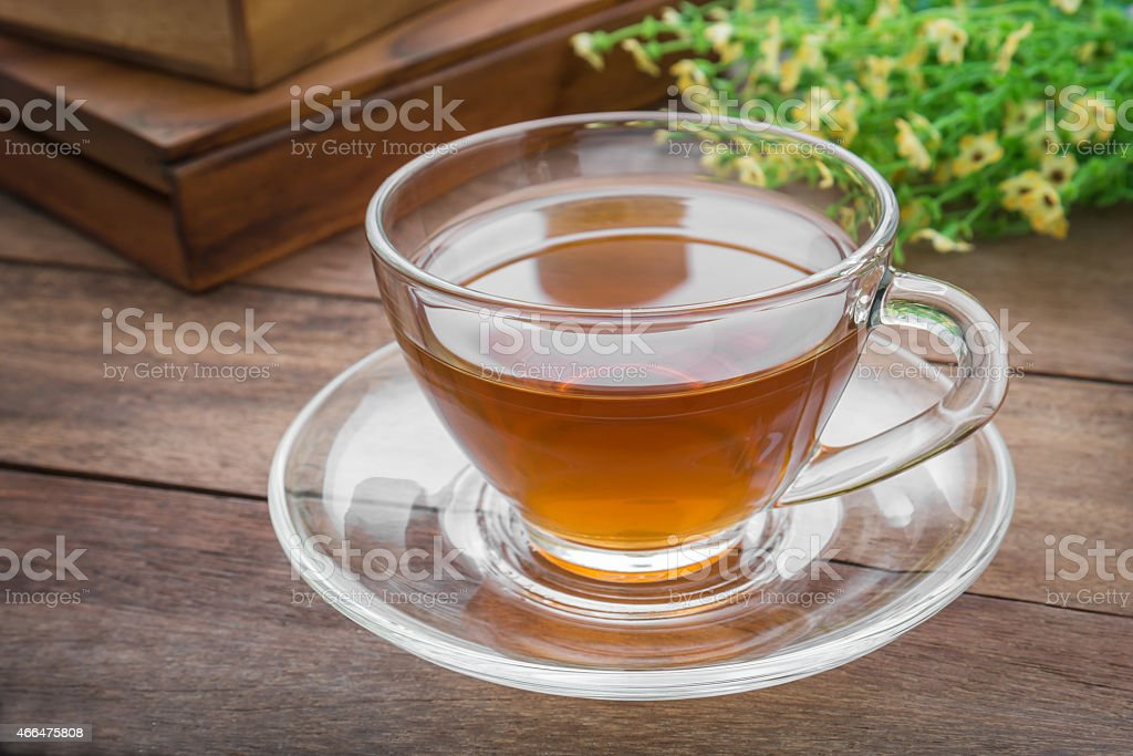 Cup of tea on wooden table stock photo