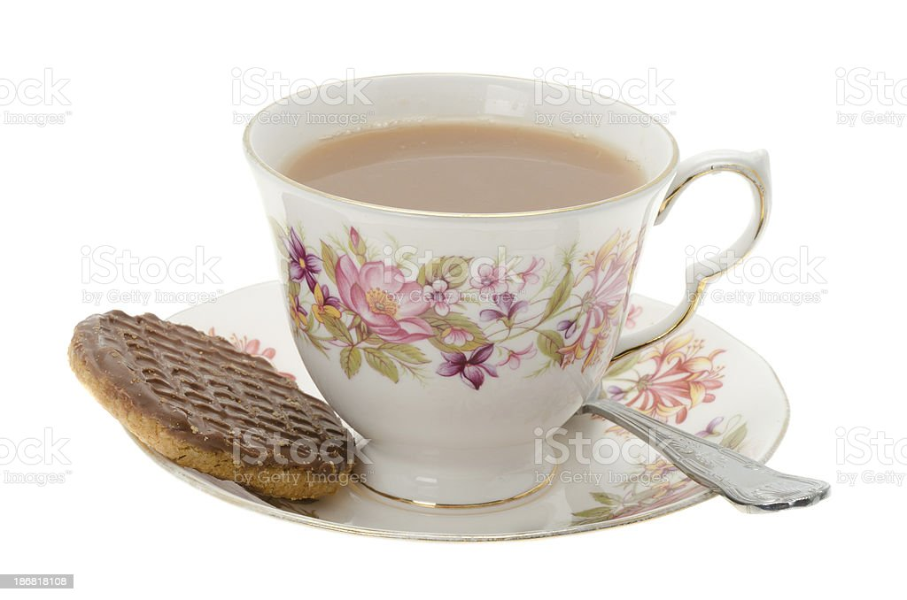 Cup of tea with a chocolate biscuit royalty-free stock photo