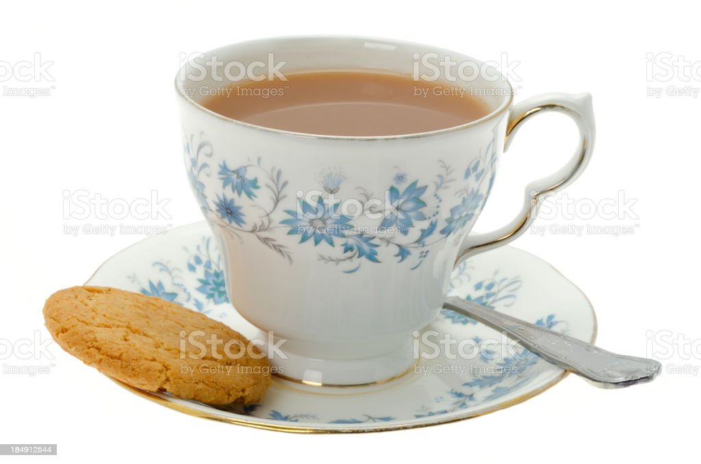 Cup of tea with a cookie biscuit stock photo