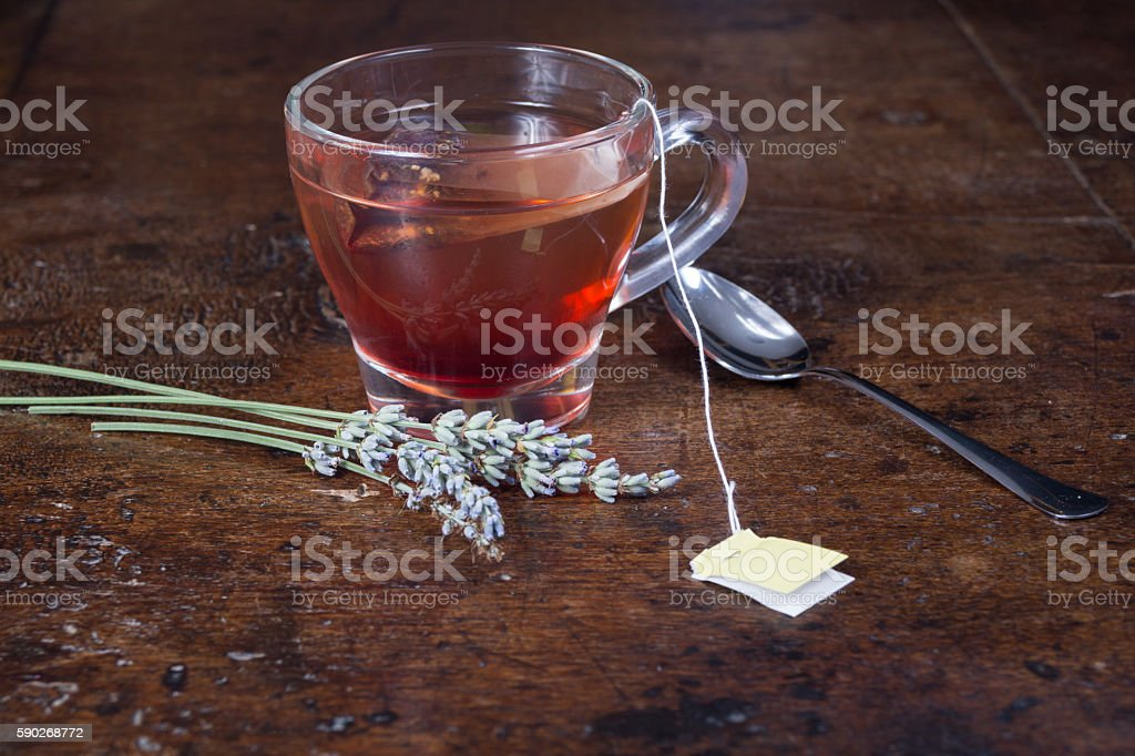 cup of tea with biscuits and lemon on top stock photo