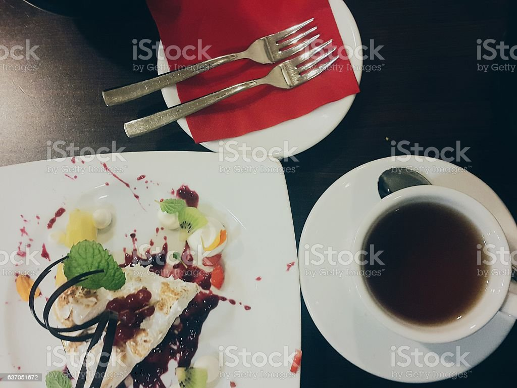 Cup of tea with cake stock photo