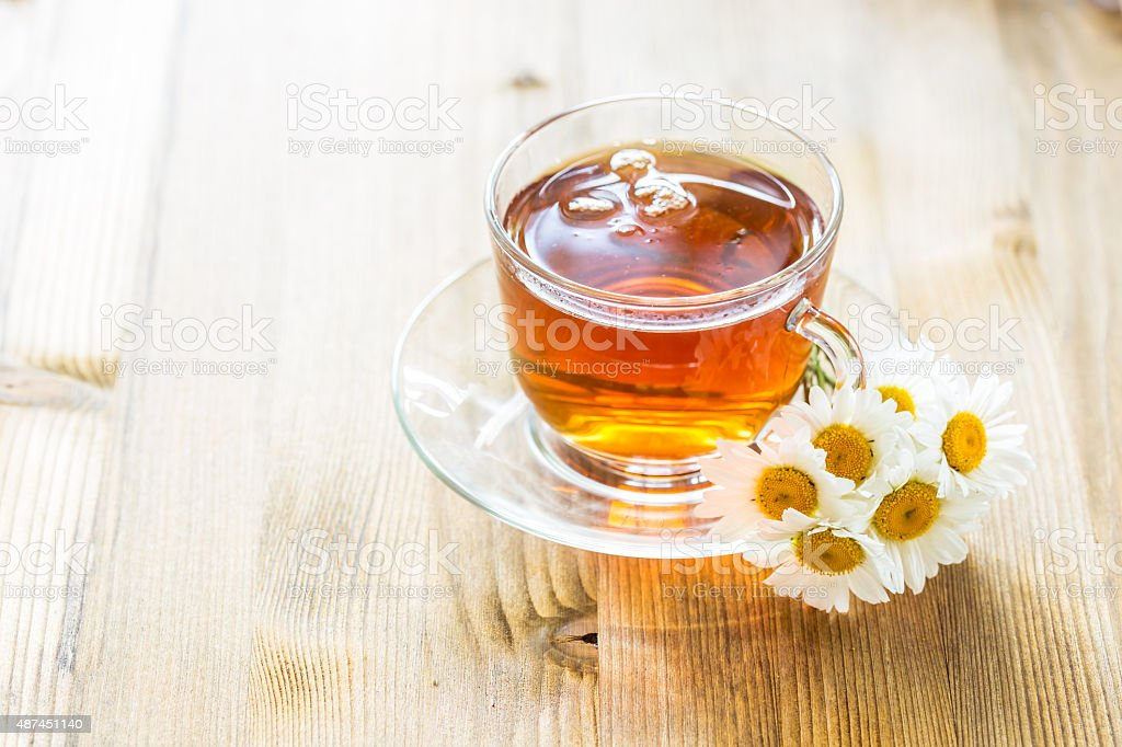 Cup of tea with chamomile stock photo