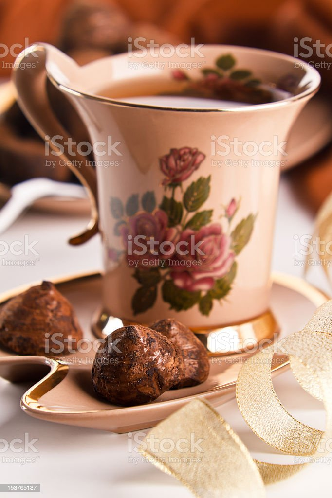 Cup of tea with chocolate truffles royalty-free stock photo