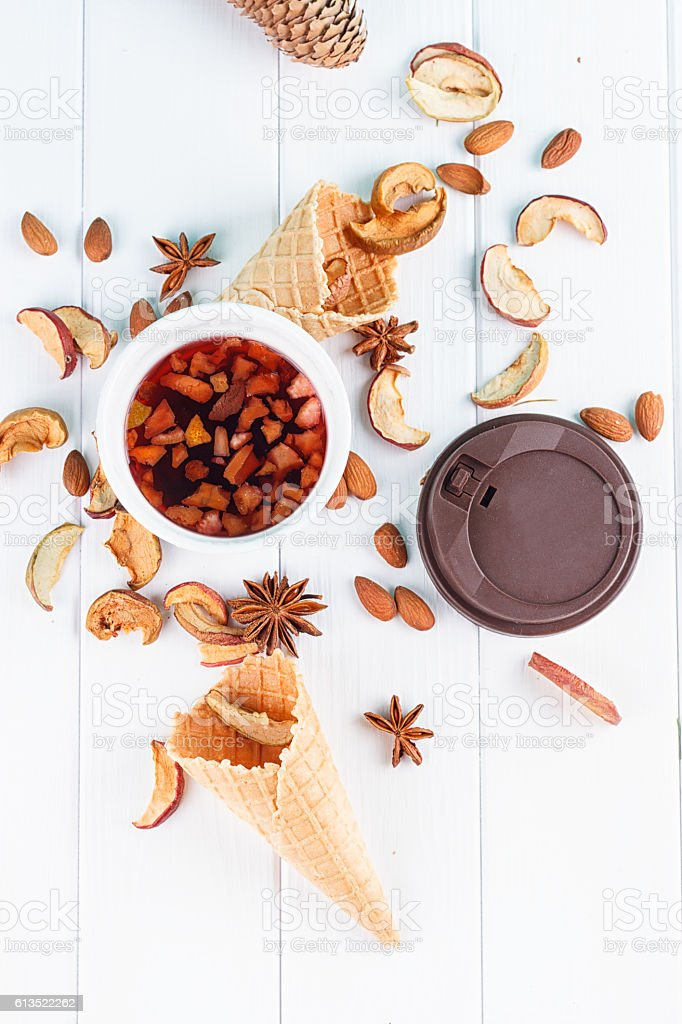 Cup of tea with dried apples, spices, fruits stock photo