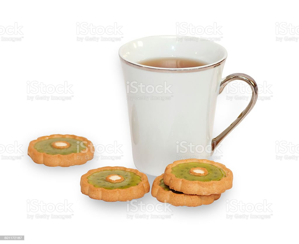 Cup of tea with few pastries isolated stock photo