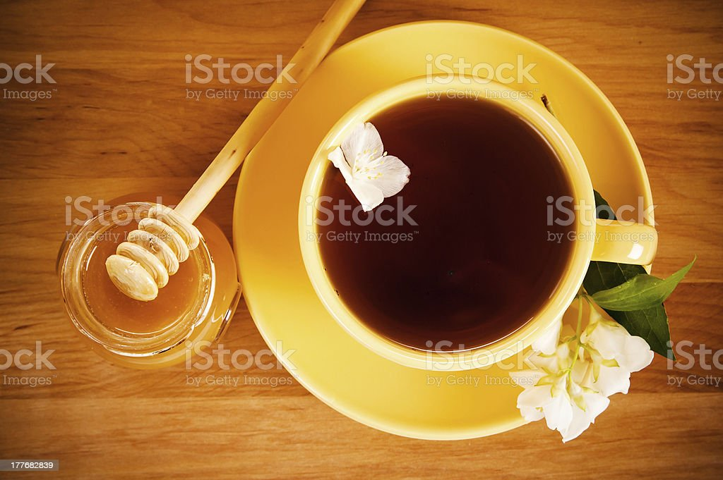 cup of tea with flower jasmin and honey royalty-free stock photo