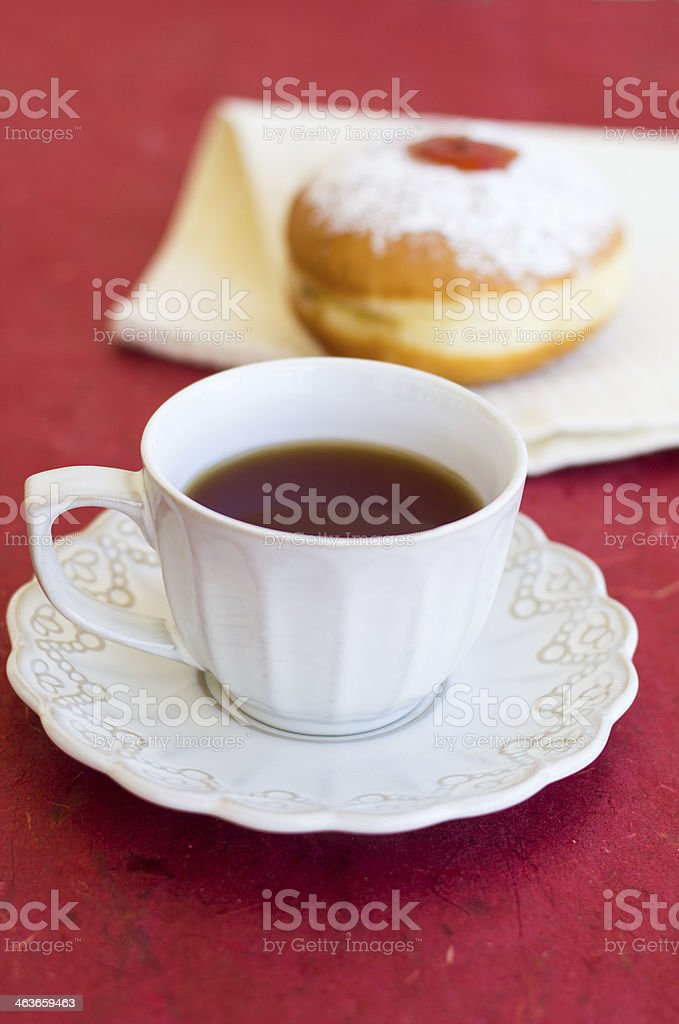 Cup of tea with fresh donut royalty-free stock photo