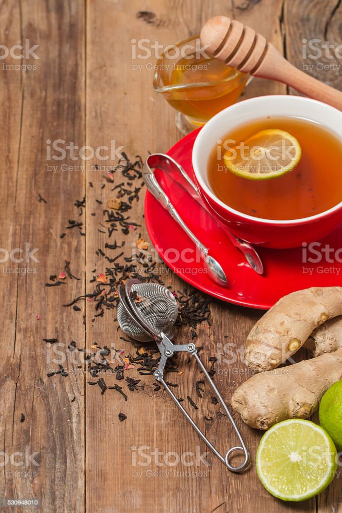 Cup of  tea with ginger,    honey and lemon stock photo