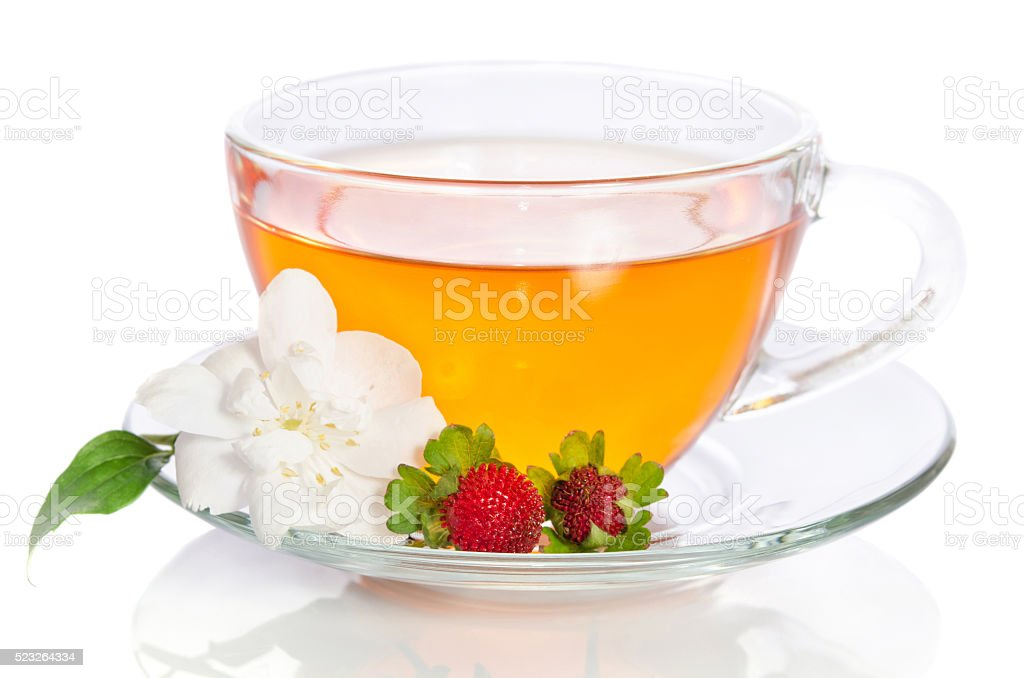Cup of tea with jasmine and strawbarries on white stock photo