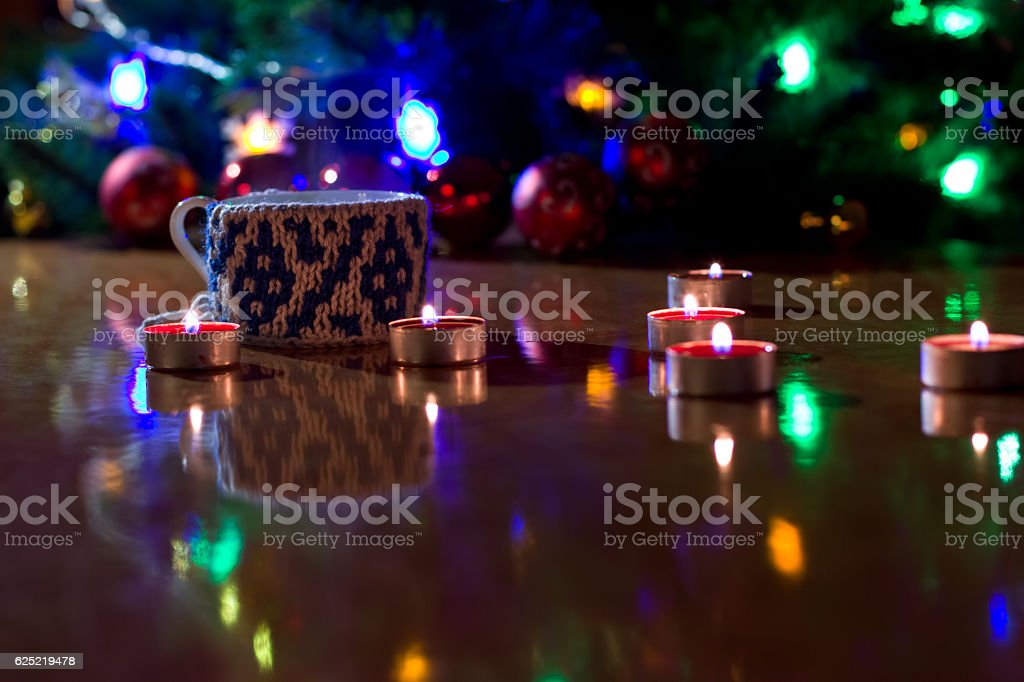 Cup of tea with knitted ornament. stock photo