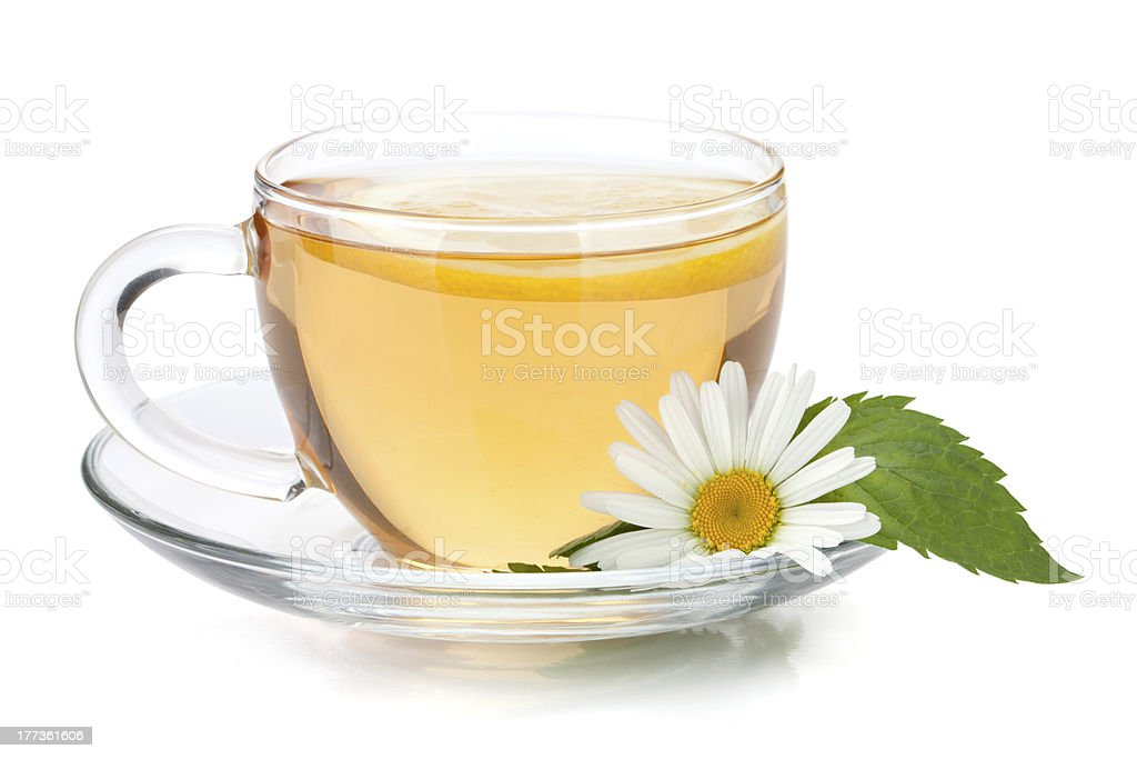 Cup of tea with lemon, mint and chamomile flower stock photo