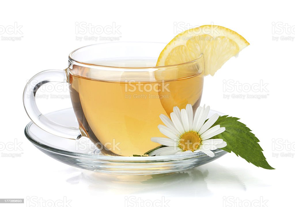 Cup of tea with lemon slice, mint and chamomile royalty-free stock photo