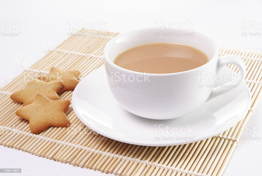 Cup of tea with milk stock photo