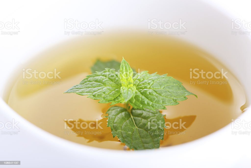 cup of tea with peppermint close up stock photo