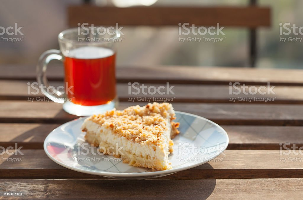 Cup of tea with piece of cake. stock photo