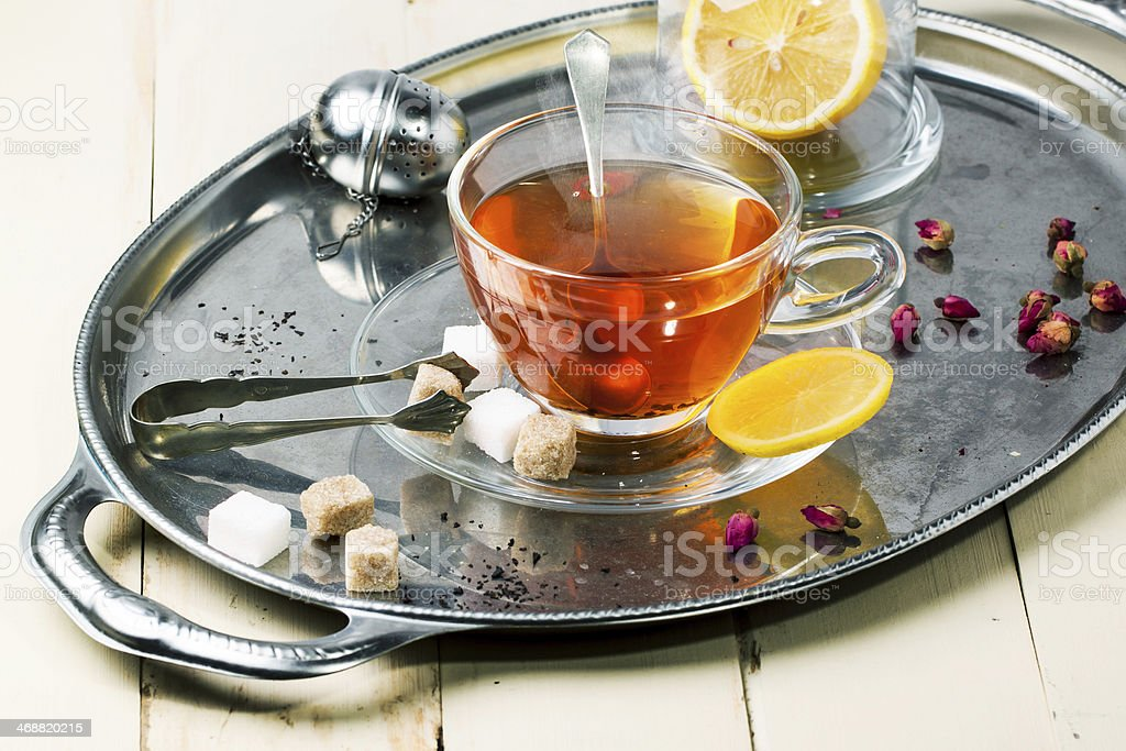 Cup of tea with sugar and lemon royalty-free stock photo