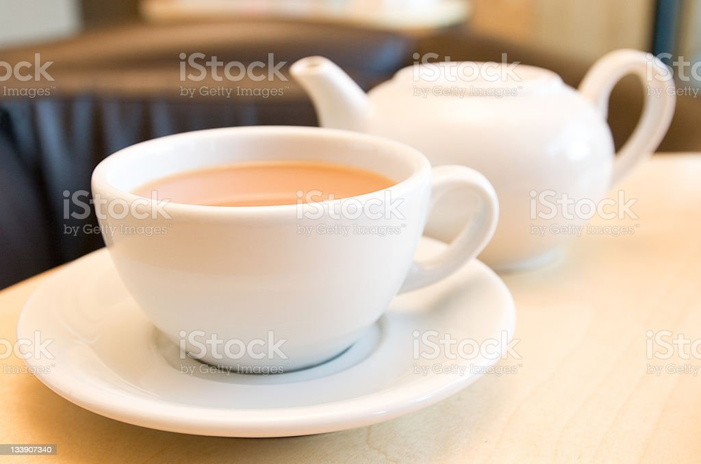 Cup of tea with teapot stock photo