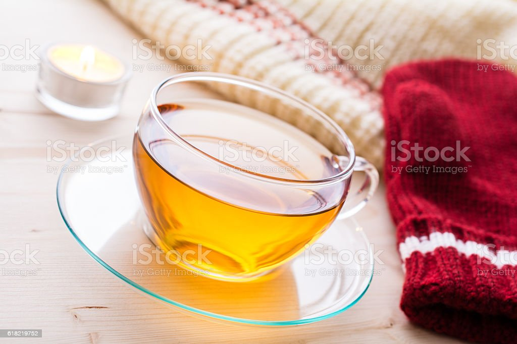Cup Of Tea With Winter Clothing And A Tealight stock photo