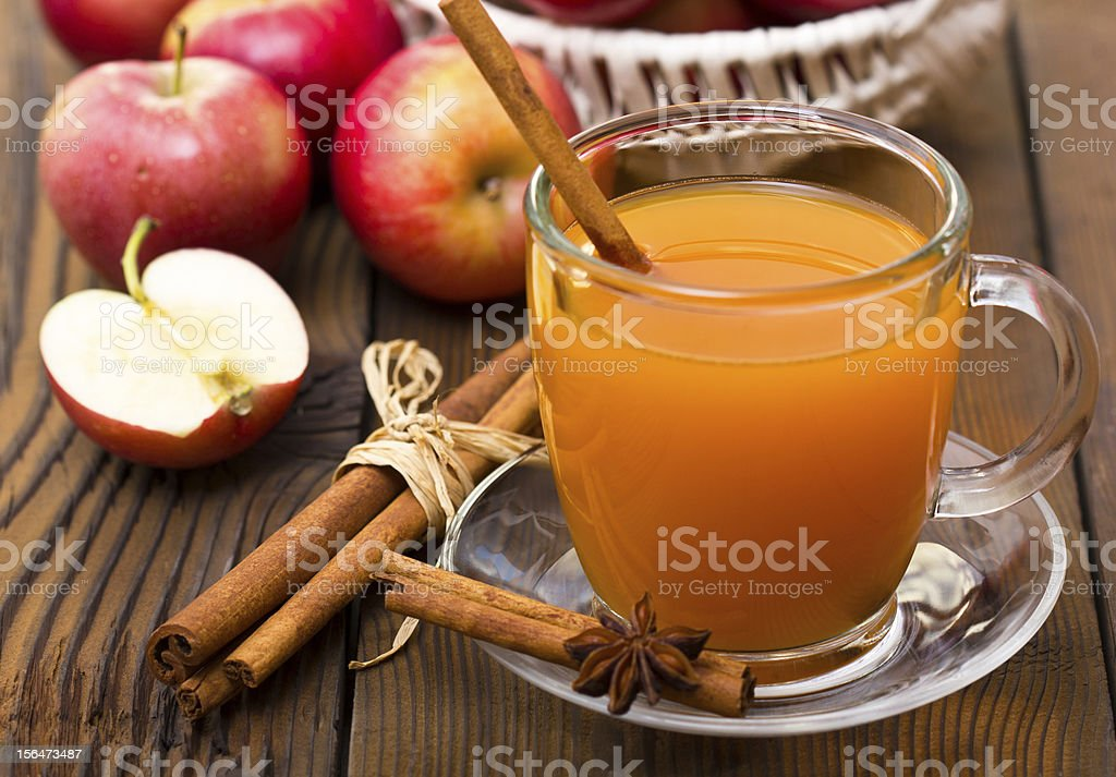 A cup of warm apple cider with cinnamon stock photo