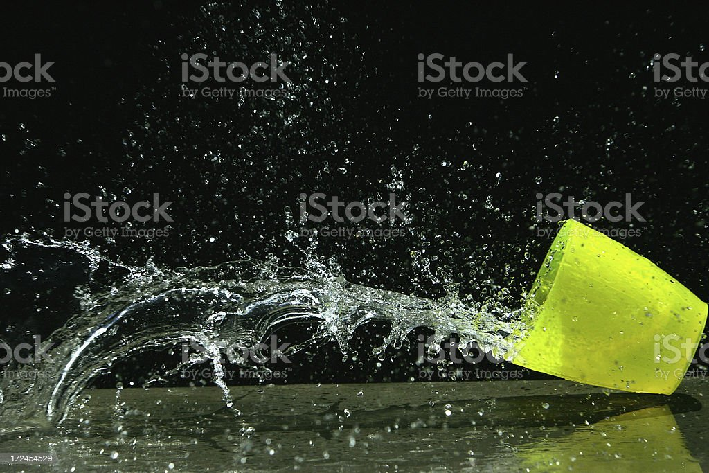 Cup of Water Spilling royalty-free stock photo