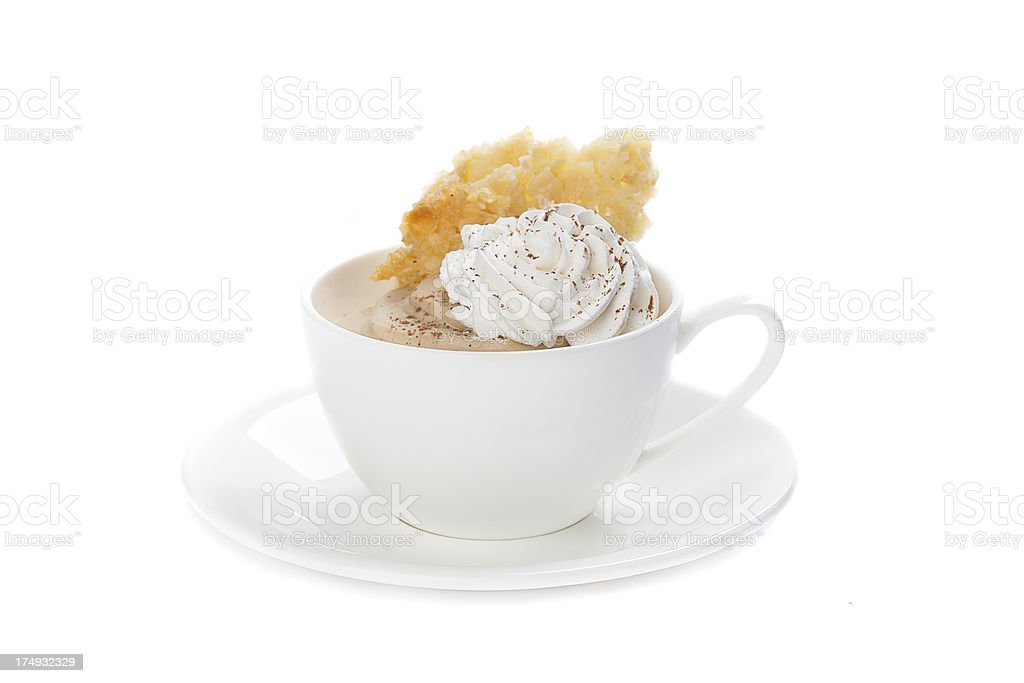 Cup of whipped cream with a red berry royalty-free stock photo
