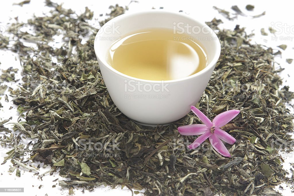 Cup of white tea with dry leaves royalty-free stock photo