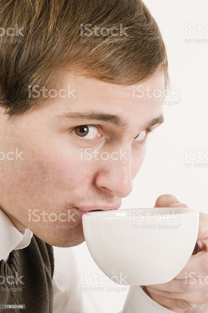 cup on mouth of young man royalty-free stock photo
