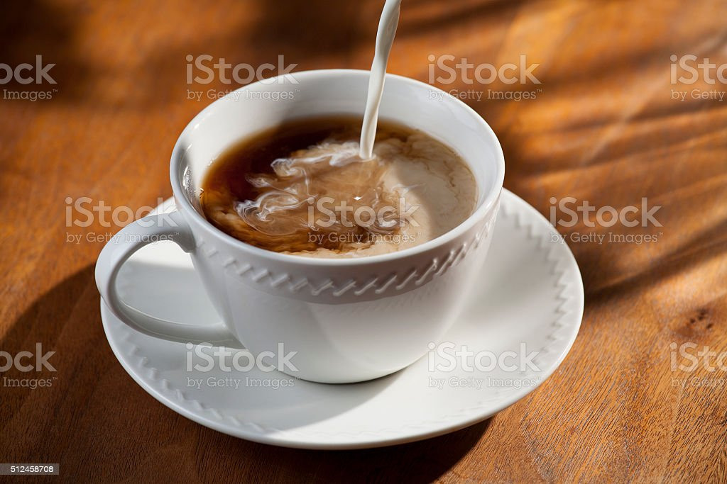 Cup or Coffee with Pouring Creamer stock photo