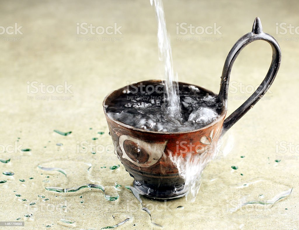 Cup Overflowing with Water royalty-free stock photo