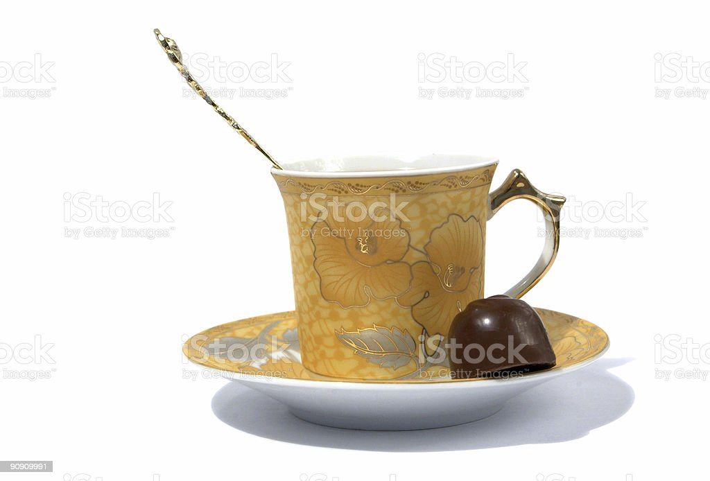 cup, spoon and chocolate on saucer royalty-free stock photo