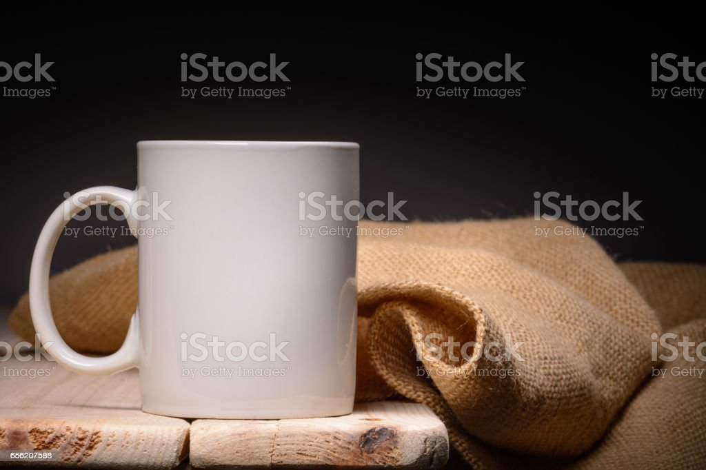 Cup white on wooden table, with space for your text stock photo