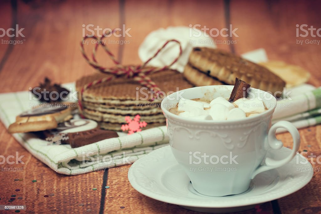 Cup with a hot drink, biscuits and waffles stock photo