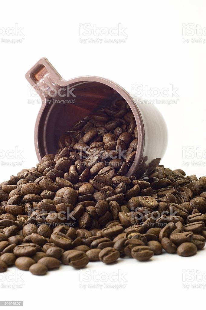 Tasse de café avec les grains de café photo libre de droits