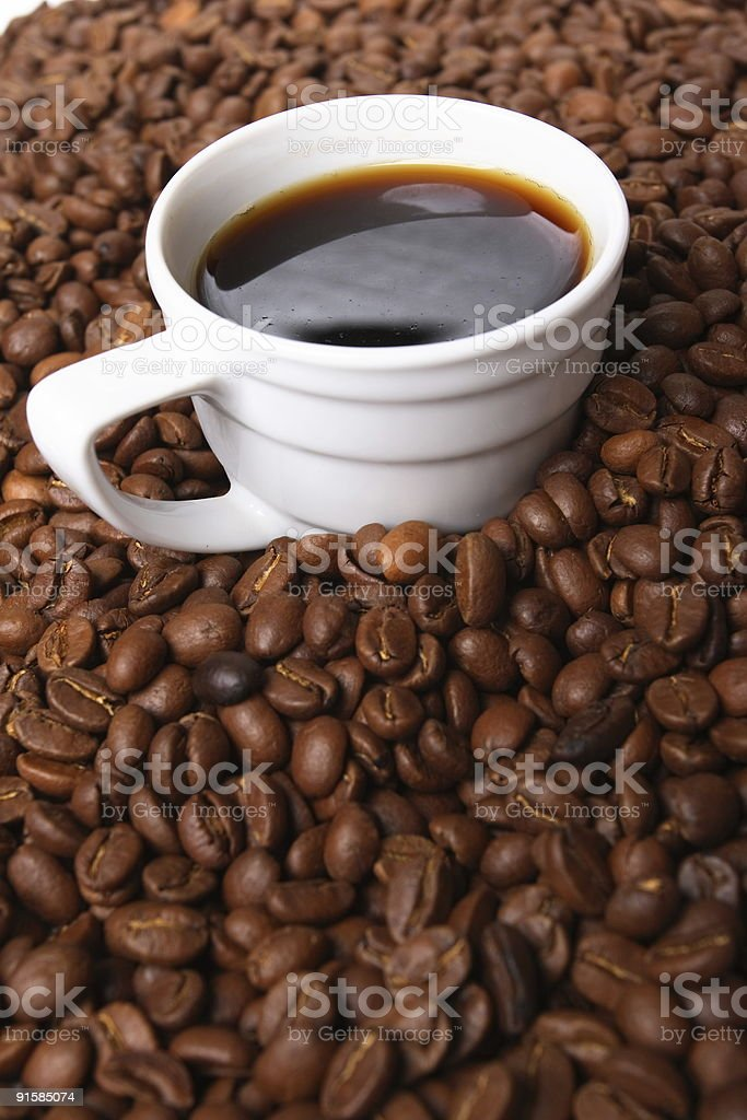 Cup with coffee, costing on grain royalty-free stock photo